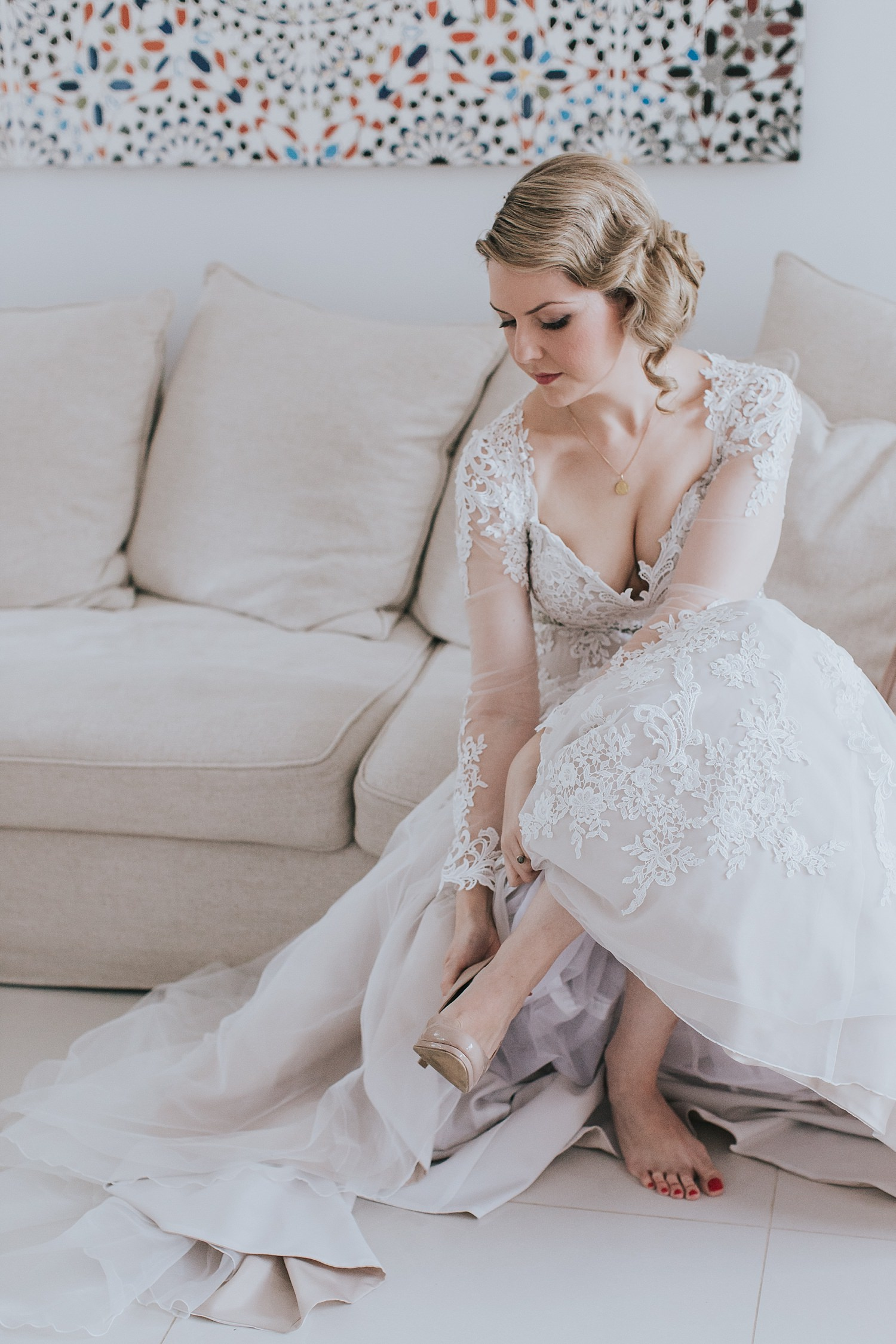 bride wearing her shoes on wedding morning in sydney