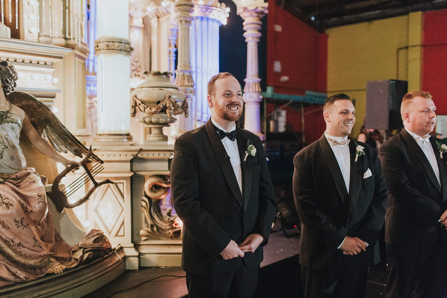 groom waiting for his bride at fairground follies wedding reception