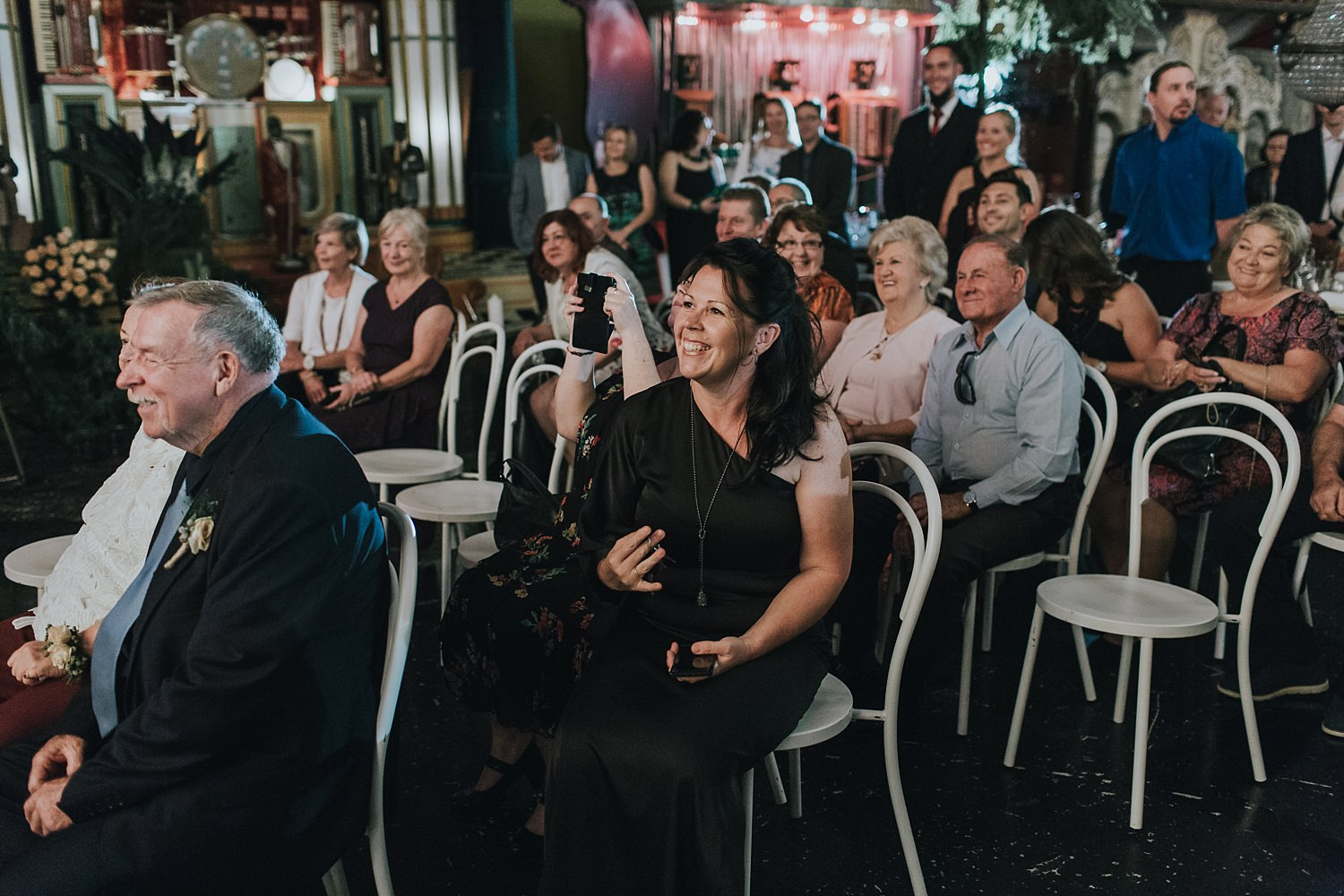 guests excited to see the groom before wedding ceremony