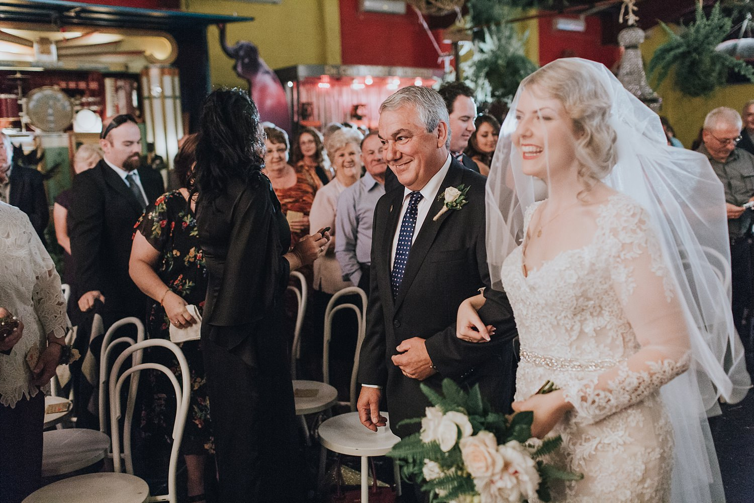 father of the bride stands beside his daughter in sydney