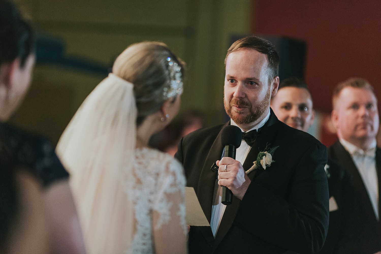 groom recites vows during sydney wedding ceremony