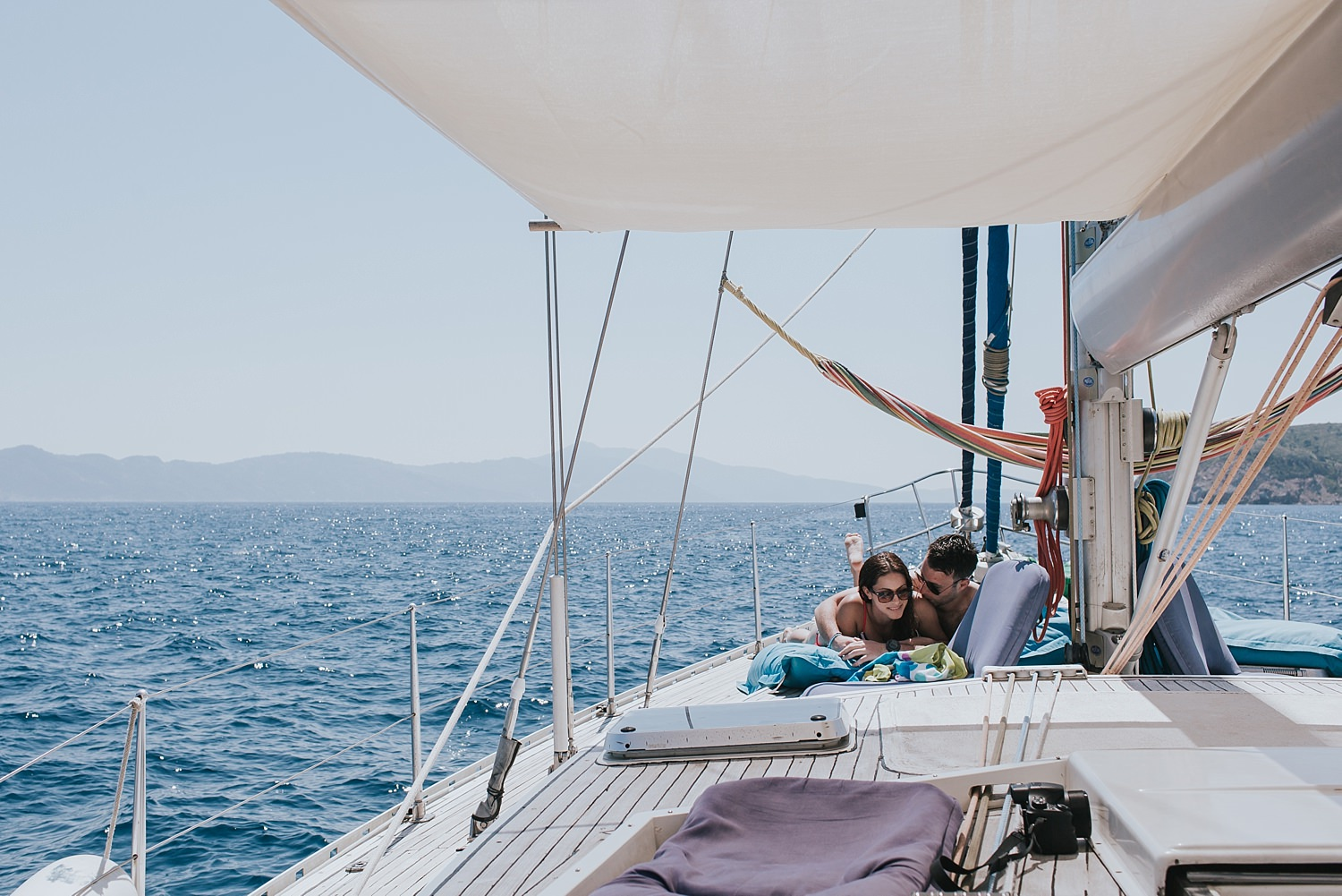 bride and groom intimate on a sailing tour of skiathos