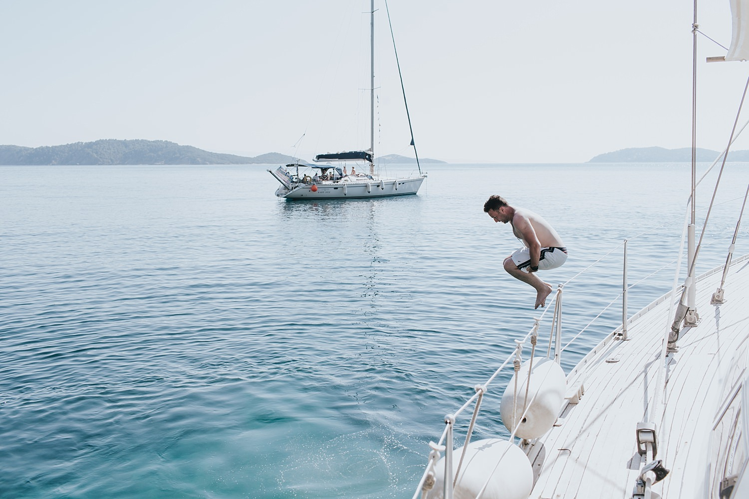 diving into water before skiathos wedding