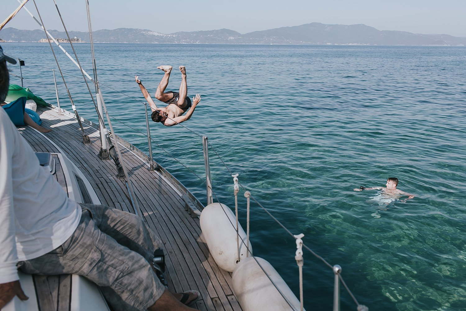 diving into the water on greek islands