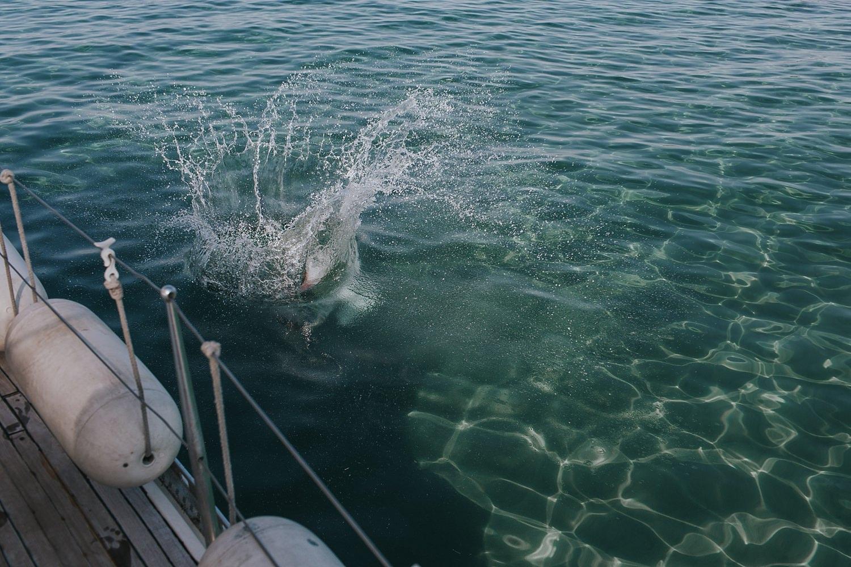 splashing into the aegean sea before wedding