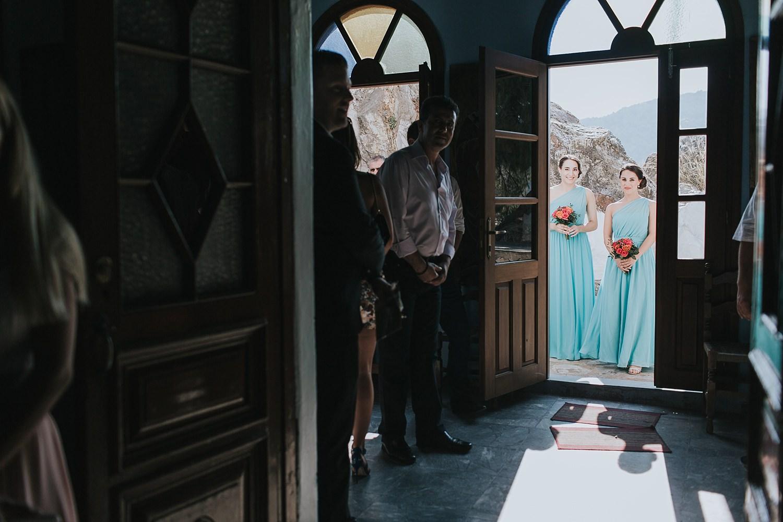 bridesmaids waiting to enter the church