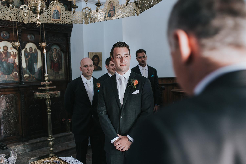 groom excited to see his bride in skiathos