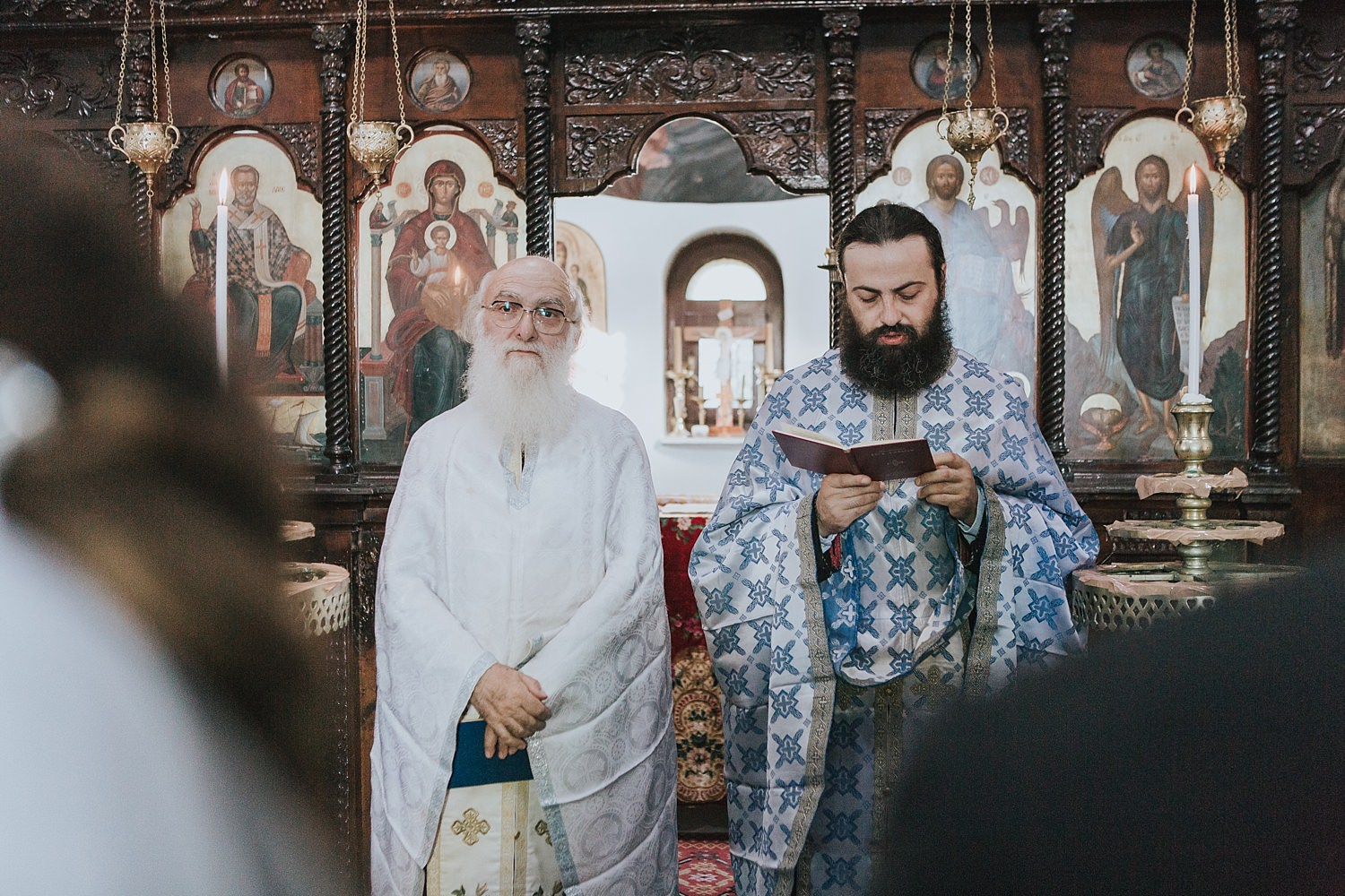 priest with his son officiate skiathos wedding ceremony