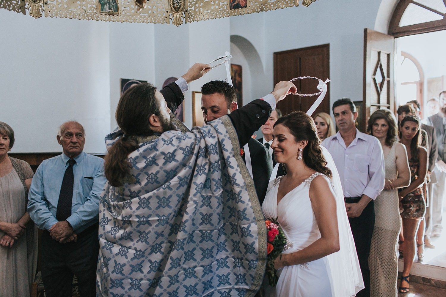 crowning the husband and wife in skiathos