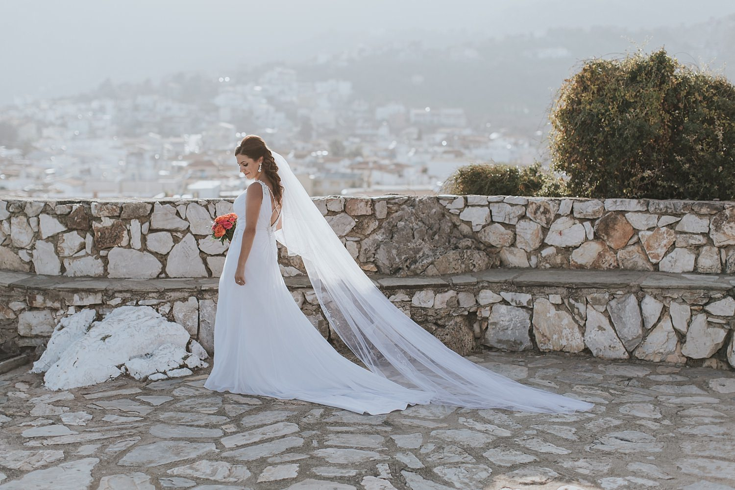 bride walks into the sun in greek islands wedding