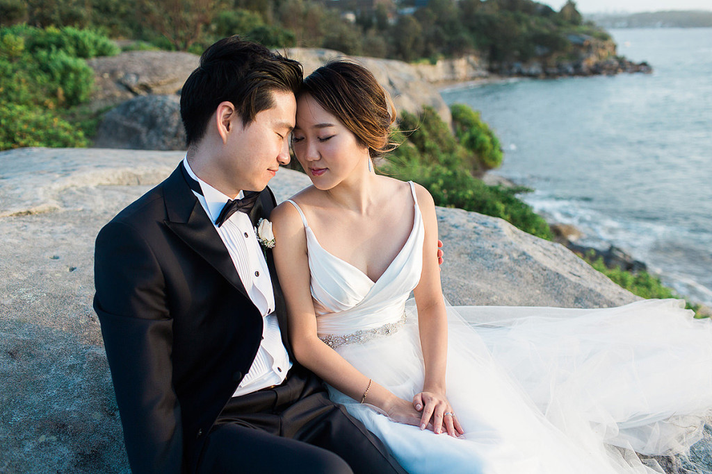 058-romantic-moment-for-bride-and-groom-at-camp-cove-headlands