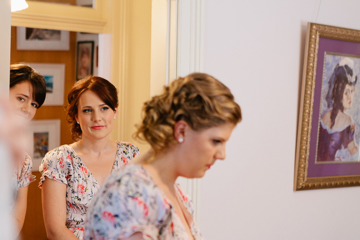 bridesmaids-watch-on-as-bride-prepares-for-wedding