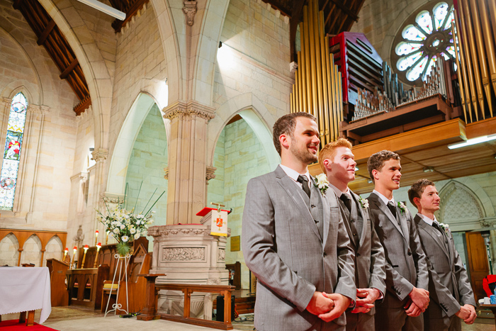 groom-and-groomsmen-waiting-for-bride