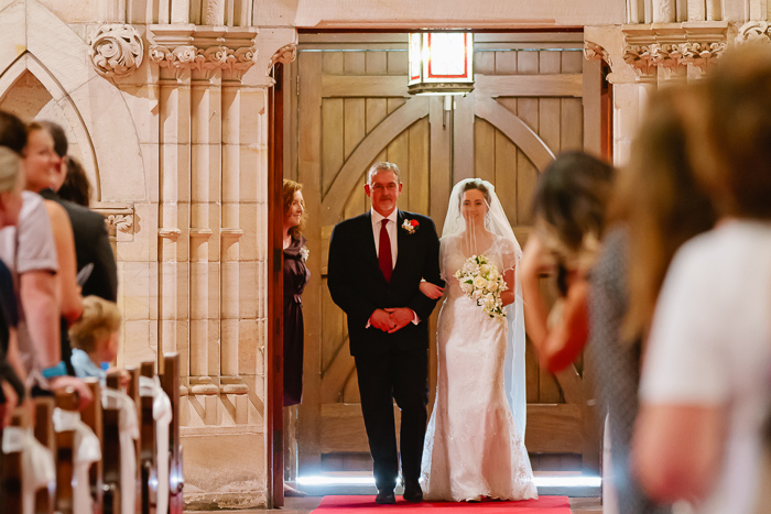 bride-walks-down-the-aisle-with-her-father