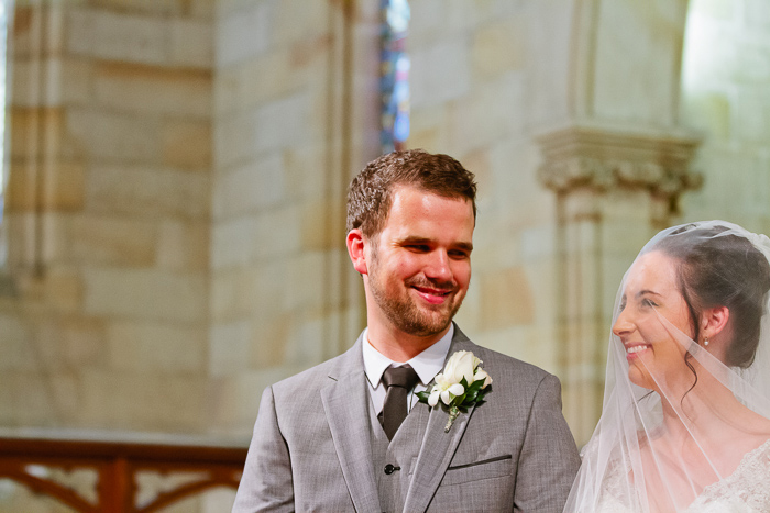 excited-couple-getting-married-in-anglican-church