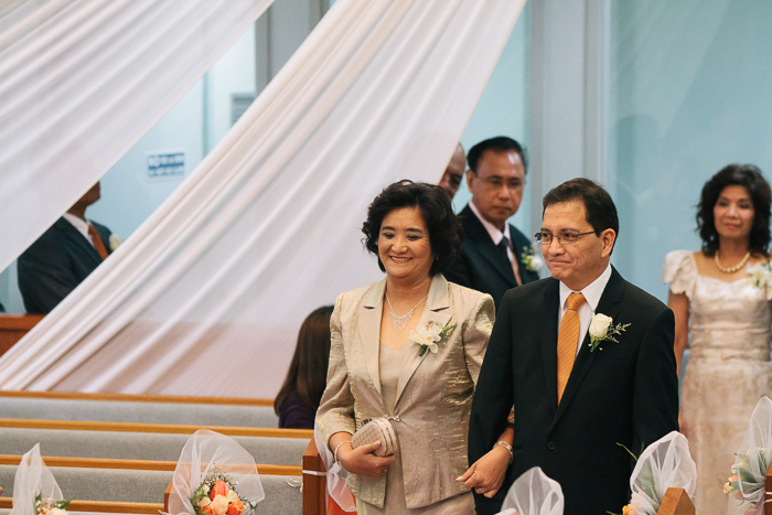 parents-of-the-groom-enter-the-wedding