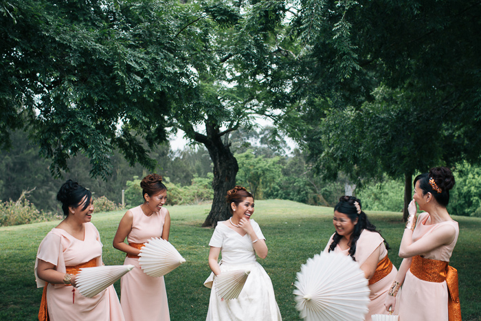 bride-with-her-bridesmaids-laughing