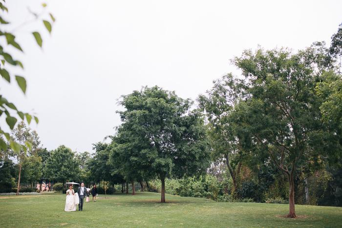 bride-and-groom-under-an-umbrella