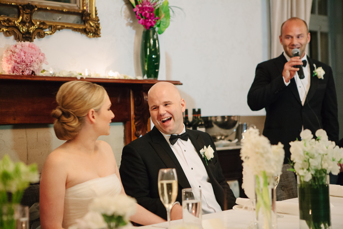 excited-groom-laughs-with-wife