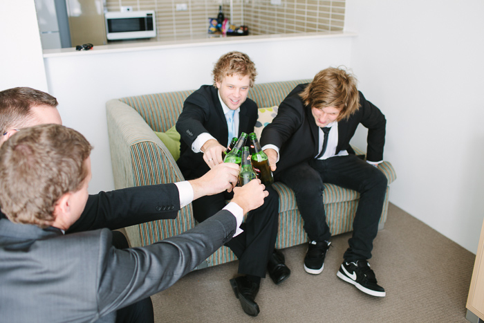 boys-sharing-a-beer-before-the-wedding