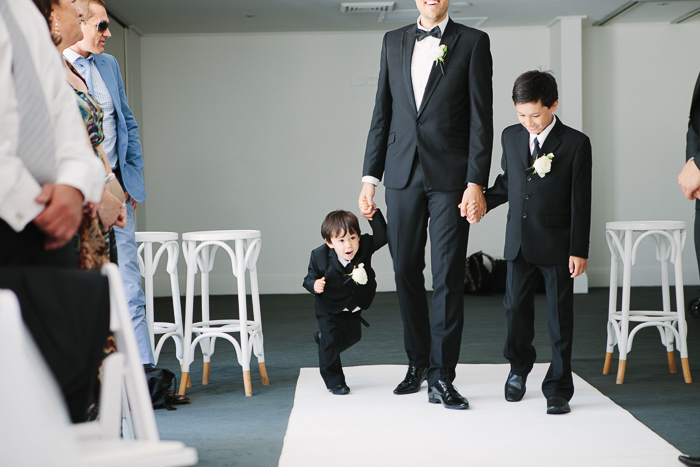 page-boy-and-bridesmaid-walking-down-the-aisle