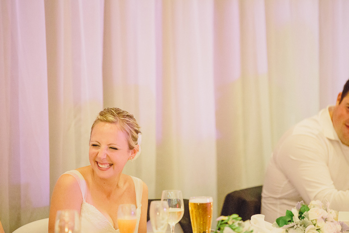 bride-laughs-at-her-own-mention