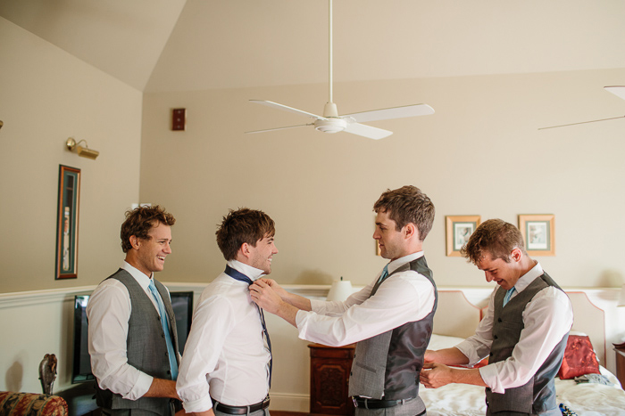 Groomsmen Helping Each Other