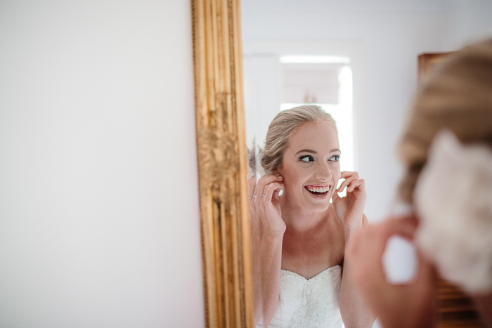 Bride Securing Her Earrings
