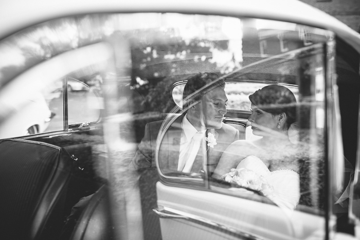 husband-and-wife-in-wedding-car