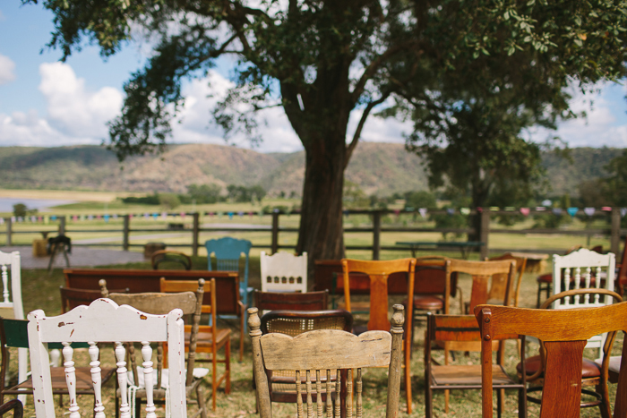 vintage-mismatched-chairs-for-wedding-ceremony