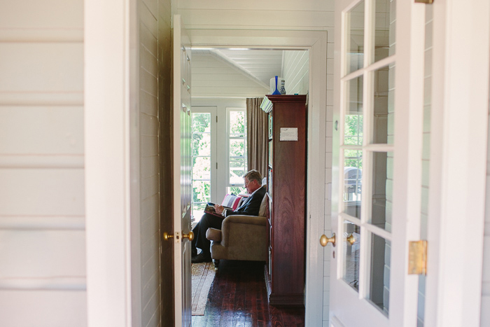 father of the bride reading in cottage