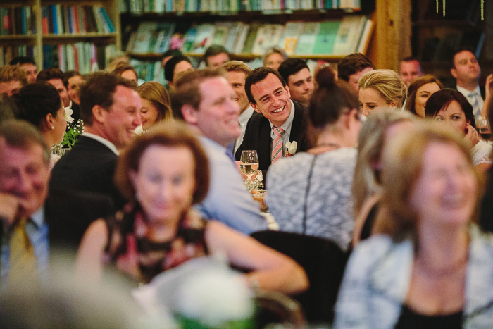 groom smiling at mothers speech