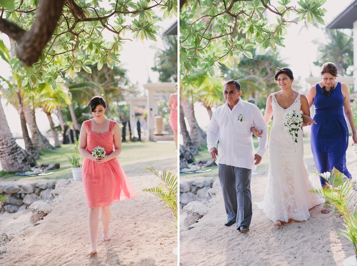 Bridesmaid and Bride walking down the beach aisle