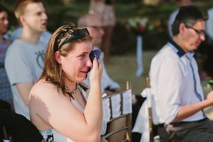 Groom's sister cries during Ceremony at Wedding