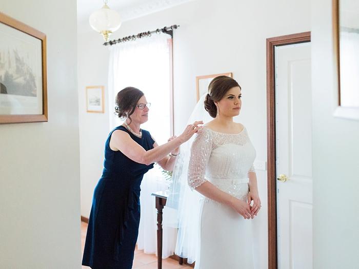 mother of the bride adjusting wedding dress in bowral