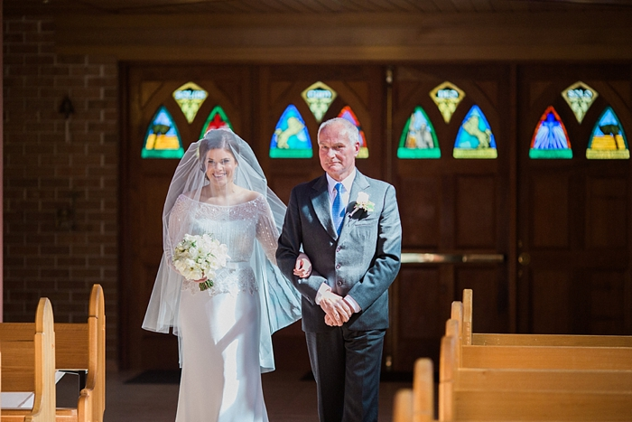 father of the bride walks daughter down the aisle