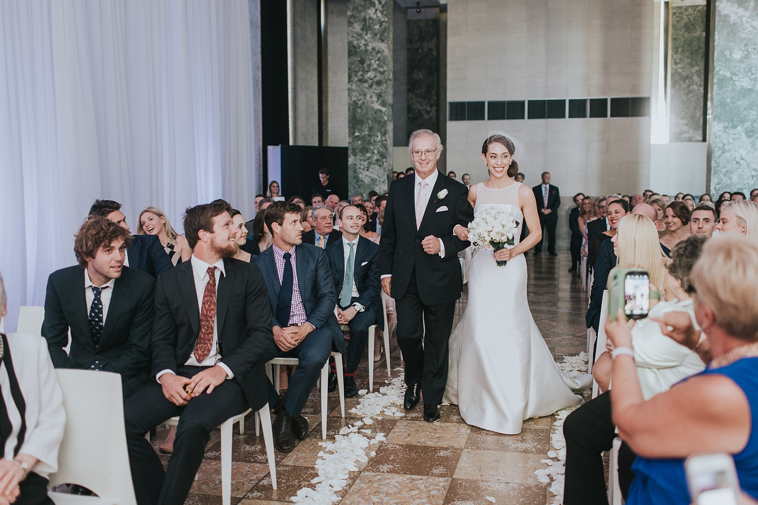 sydney bride walking the aisle at the mca