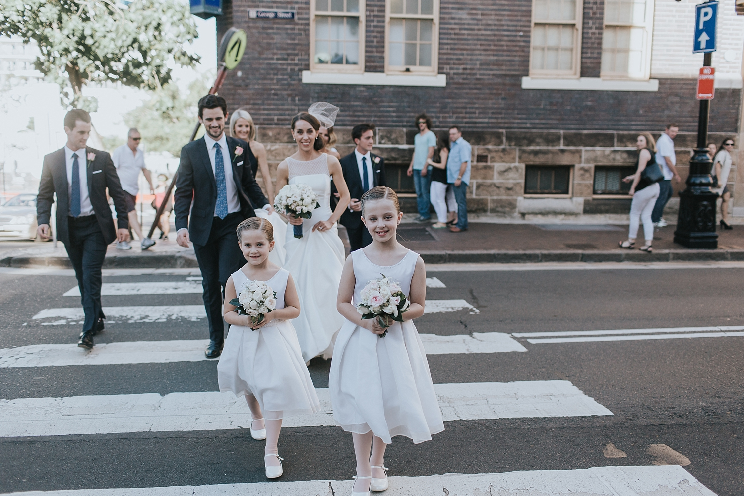 crossing the road at argyle st in the rocks with bridal party