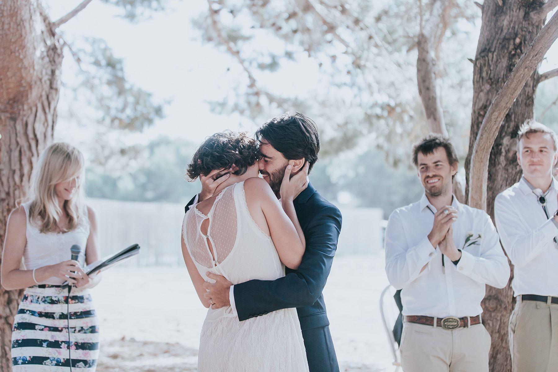 passionate embrace during wedding ceremony at narnu farm