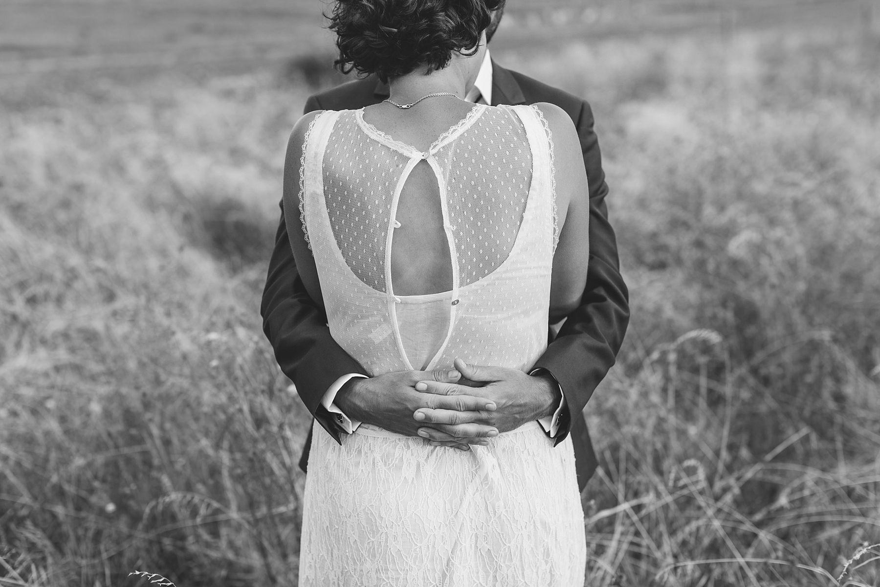 loving embrace by groom pops open her dress