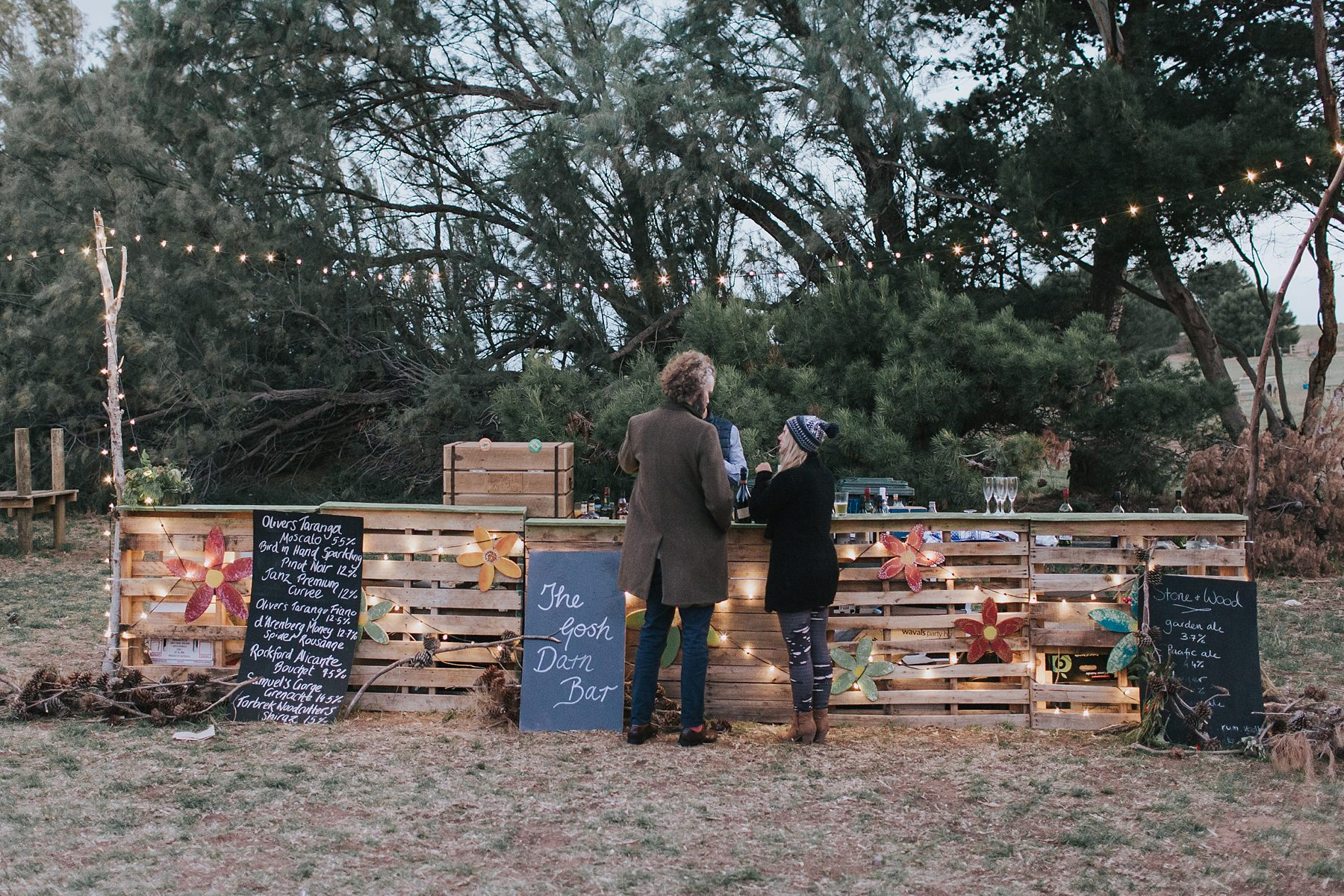 diy rustic bar at wedding reception