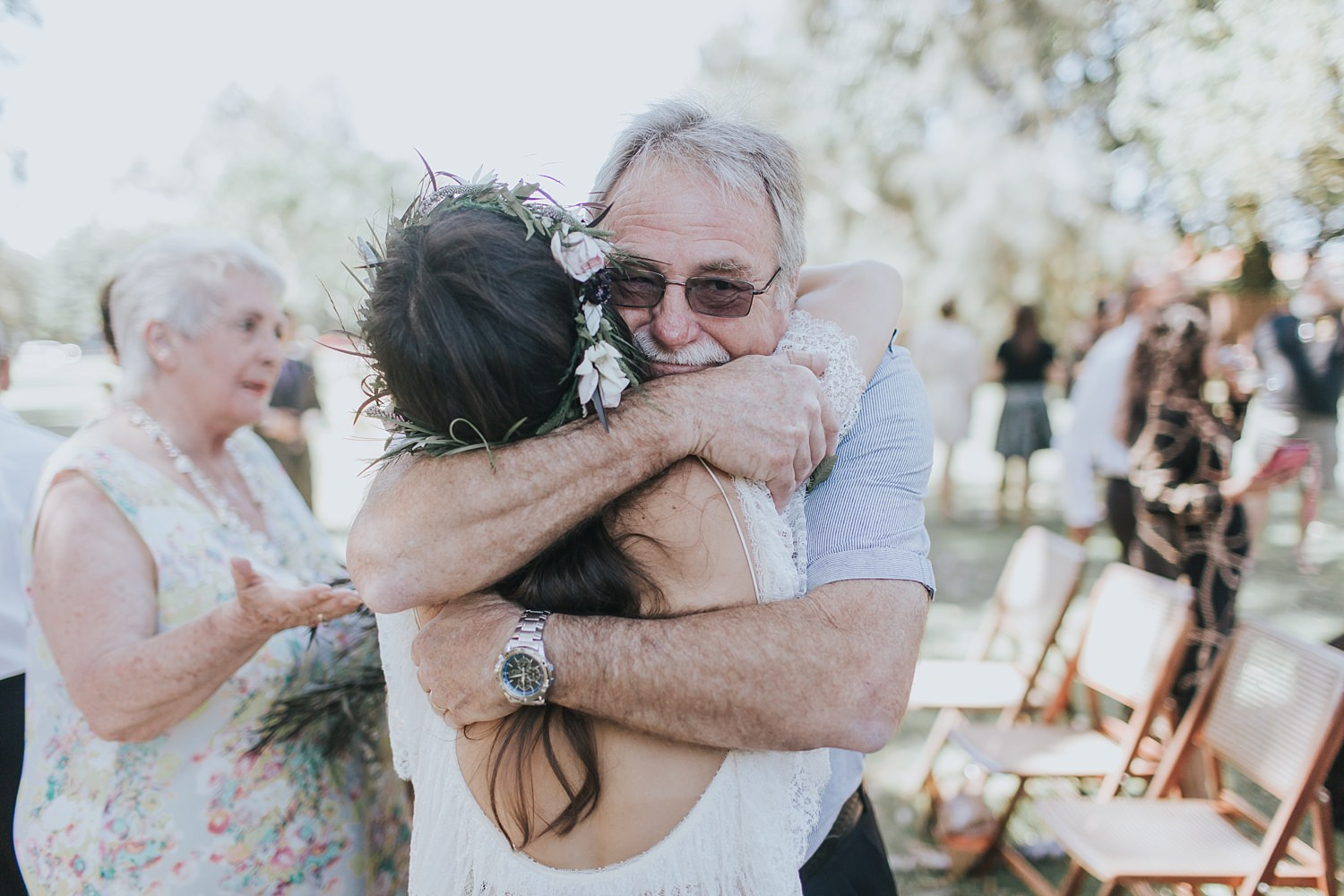 father of the bride embraces his daughter