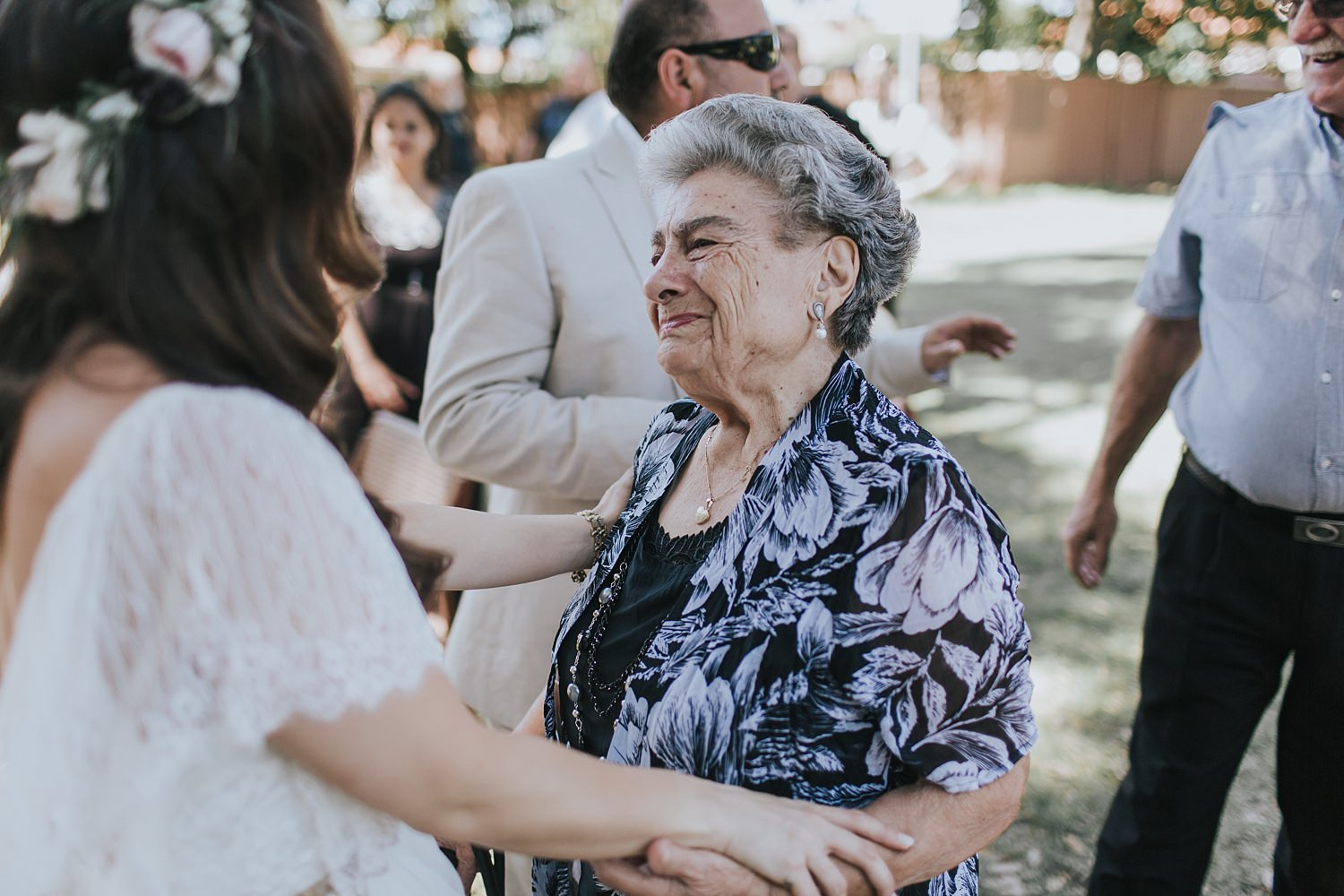 bride being congratulated by nonna after the ceremony