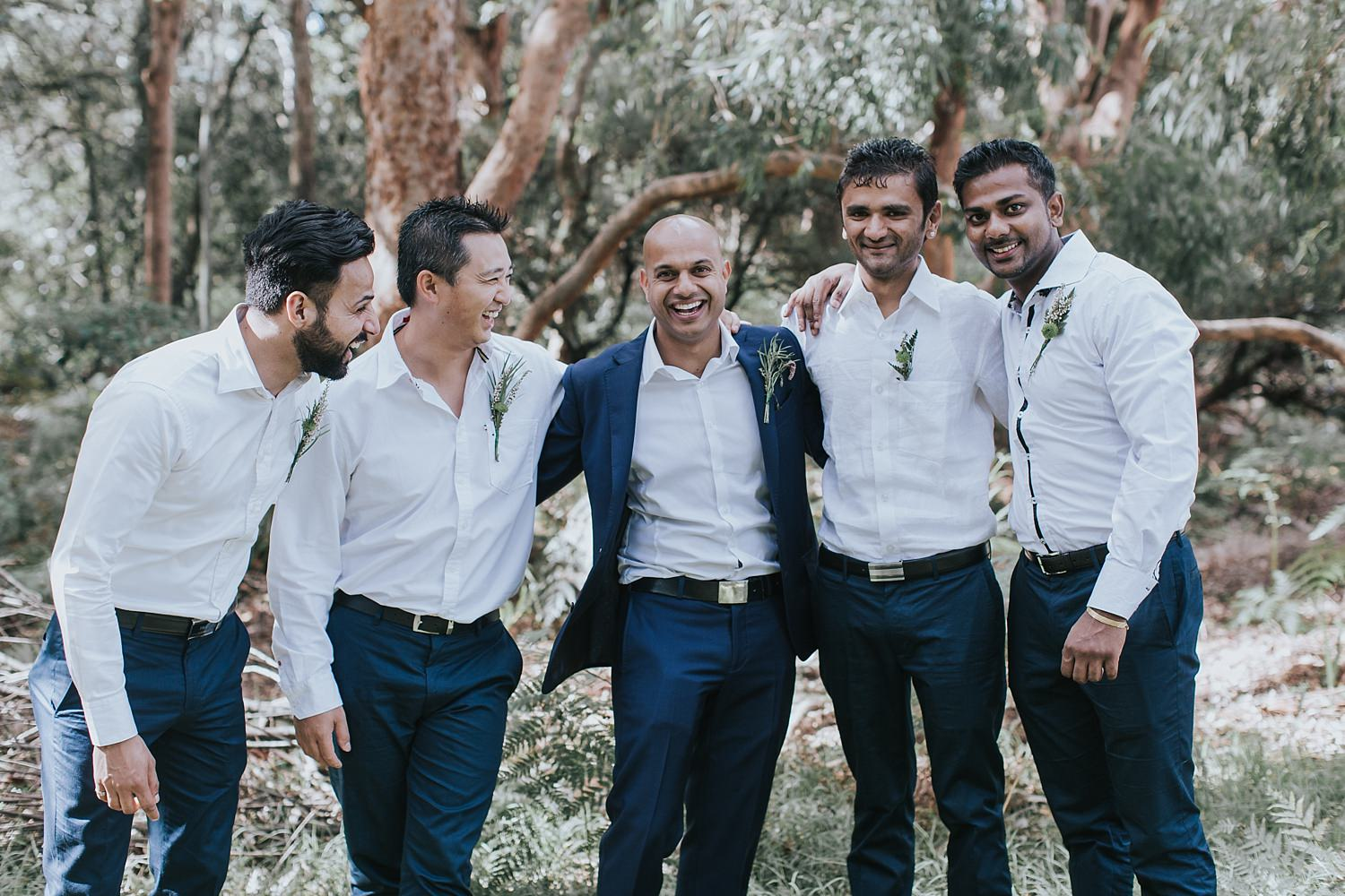 groom with his groomsmen at the grounds of alexandria