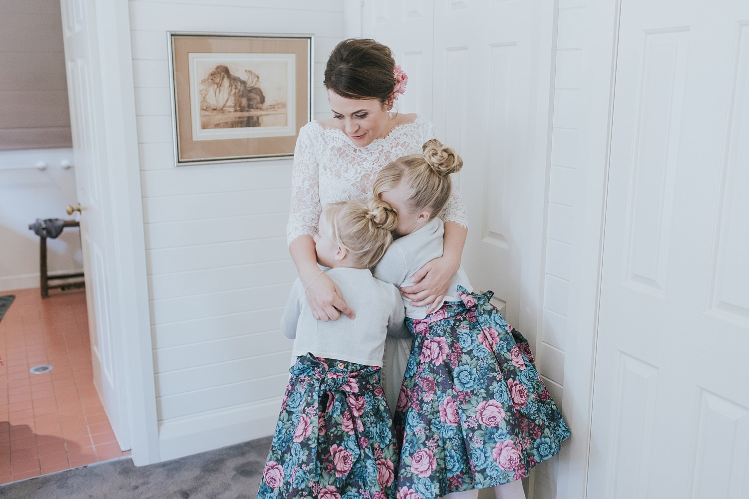 bride hugs her nieces before the wedding ceremony