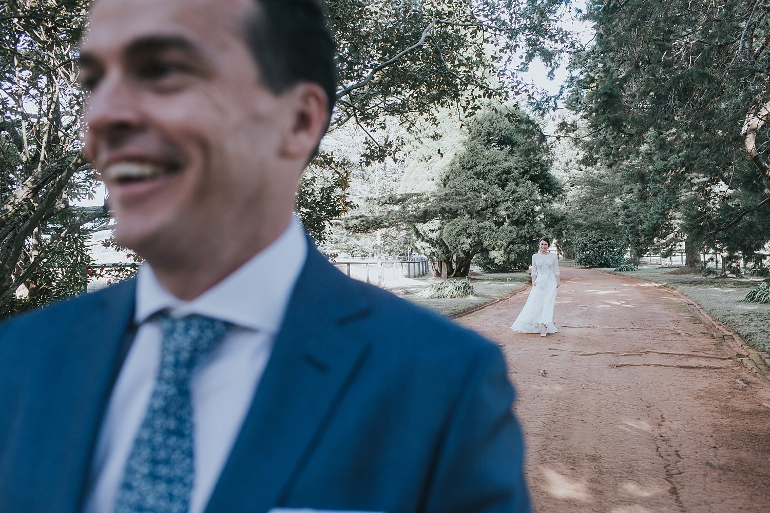bride walking towards her groom for first look at bendooley estate berrima