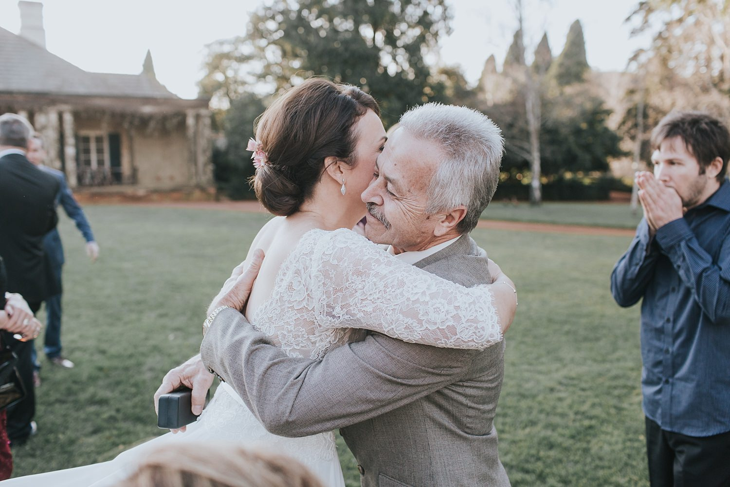 bride hugs her father at bendooley