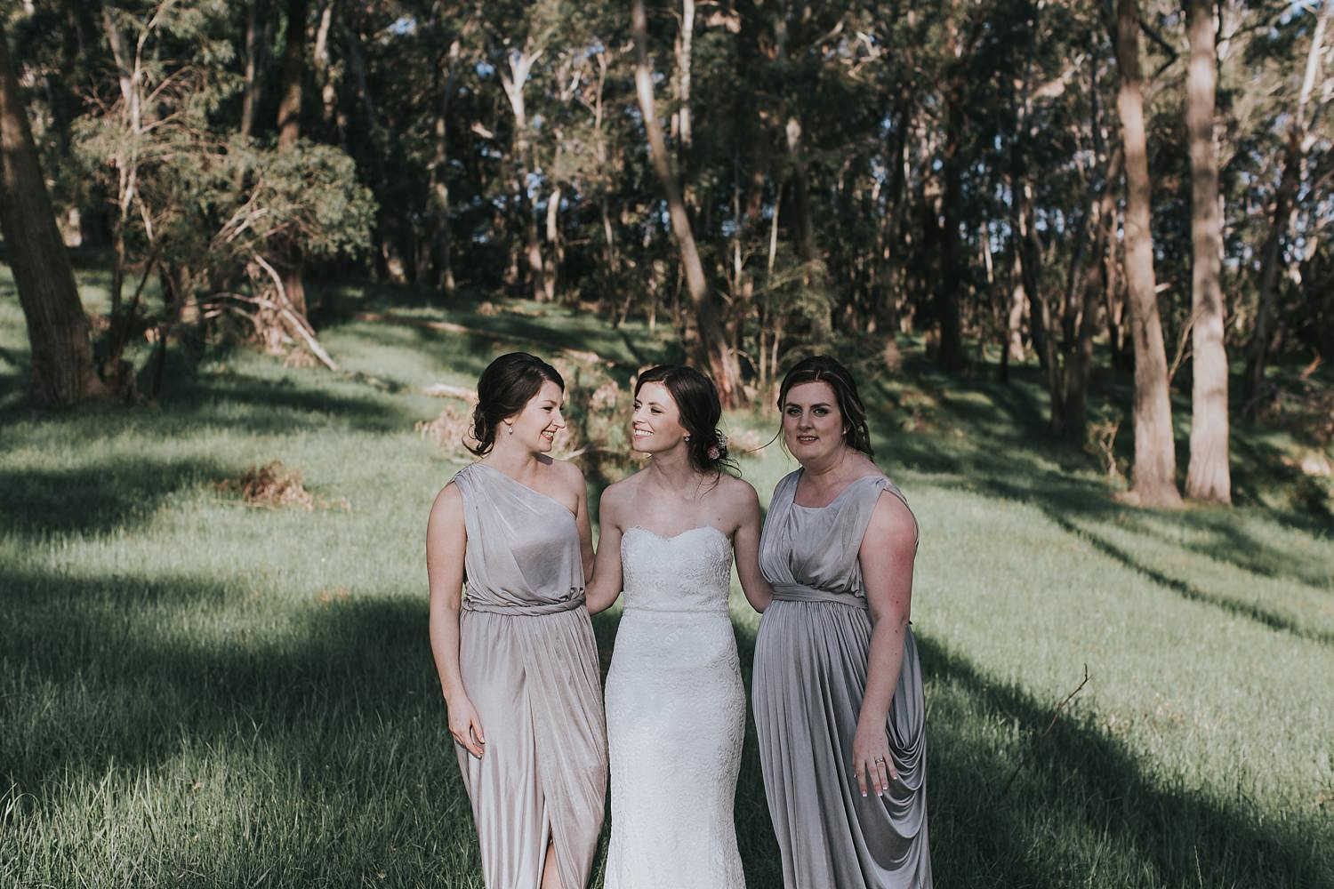 beautiful bridesmaids in centennial vineyards