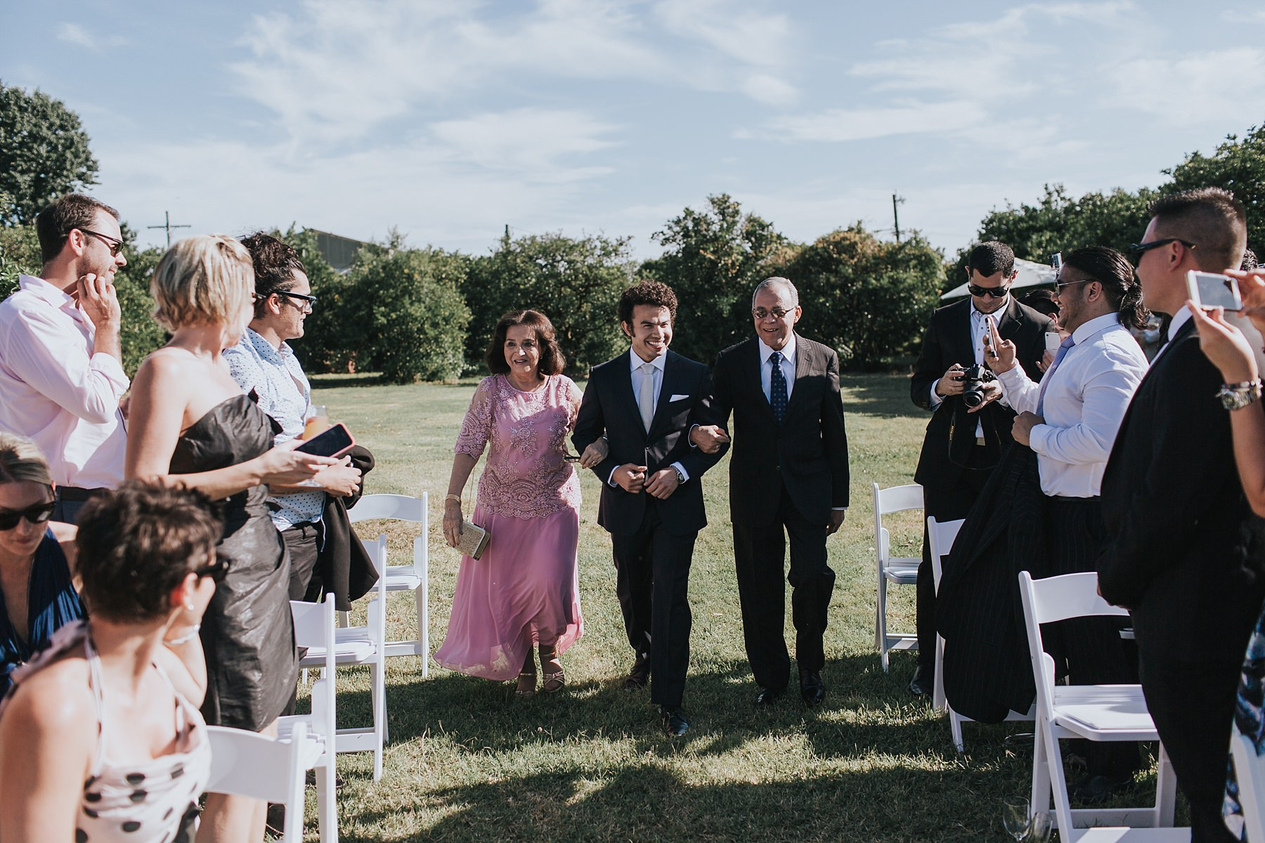 groom walked down the aisle by parents
