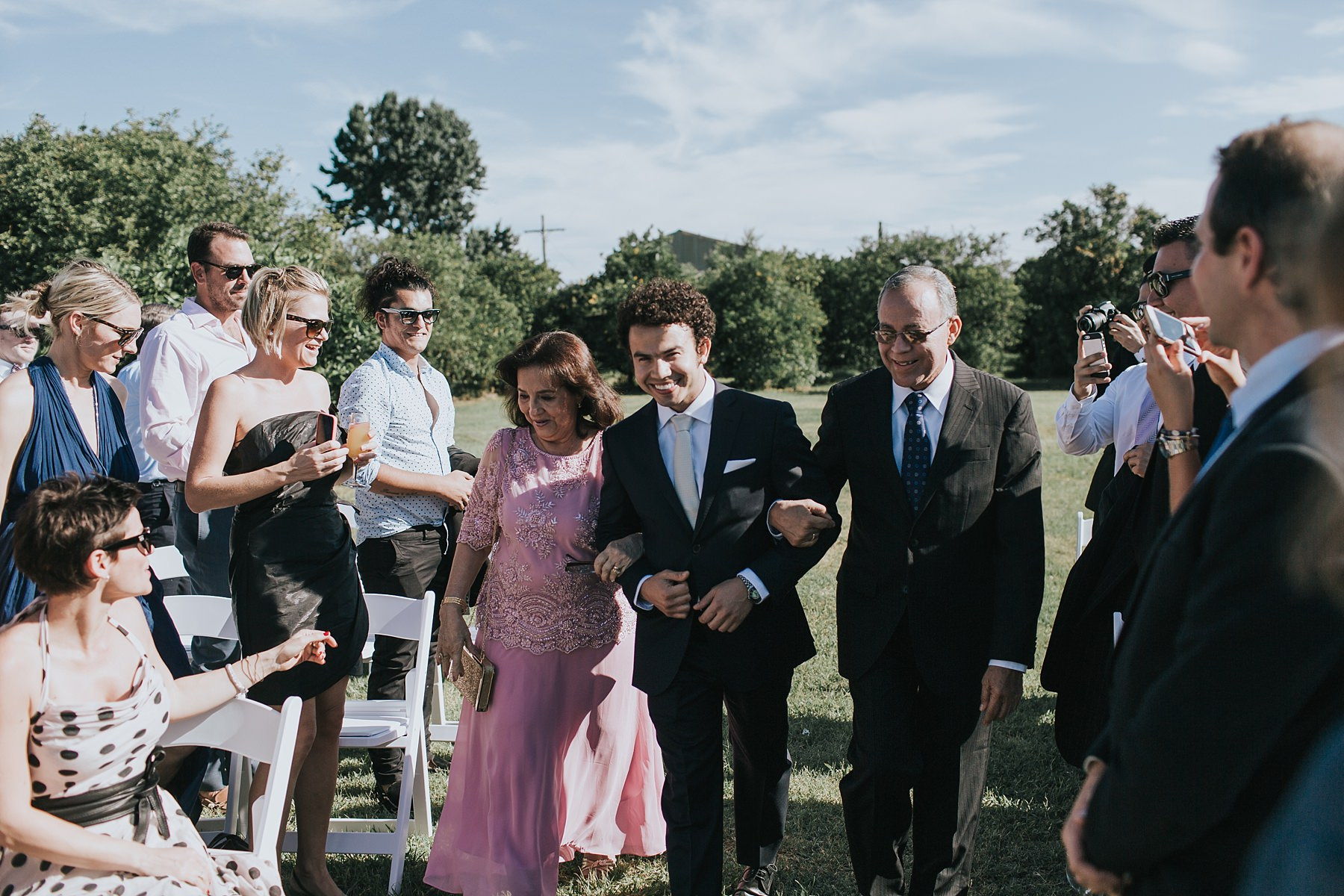 groom walking down the aisle to get married